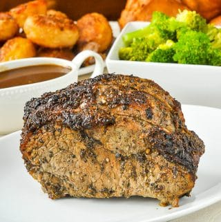 Worcestershire Butter Roast Beef shown with gravy, broccoli and roasted potatoes