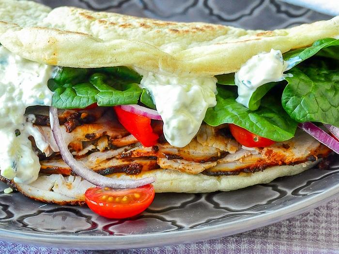 Souvlaki Roast Pork Loin close up photo of flatbread sandwich
