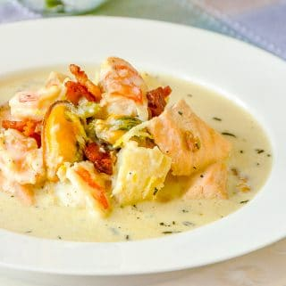 Creamy Seafood Chowder photo of a single serving in a white bowl