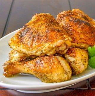 Homemade Italian Seasoning on Roast Chicken shown on white serving platter