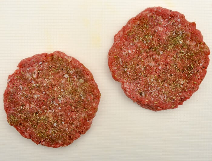Seasoned burgers ready for the grill