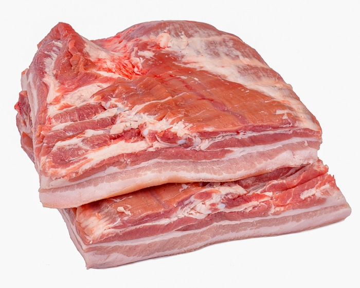 Stock photo of uncooked pork belly slabs