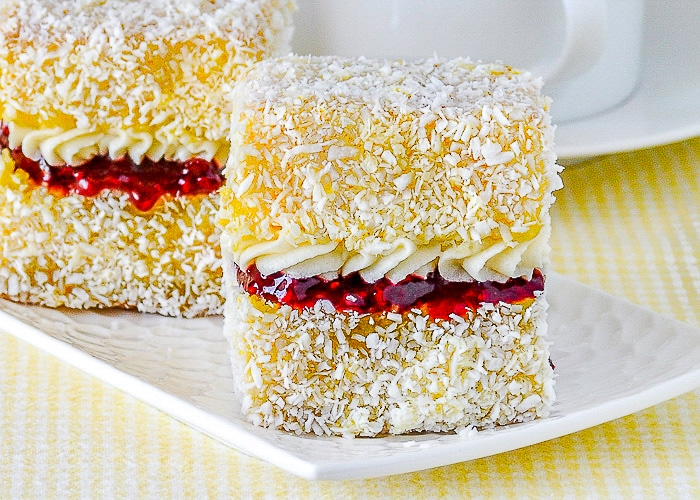 Lemon Lamingtons with Raspberry Compote and vanilla cream Copyright Barry C. Parsons https://www.rockrecipes.com/lemon-lamingtons/