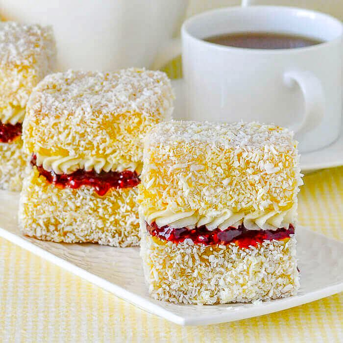Lemon Lamingtons close up photo with raspberry filling