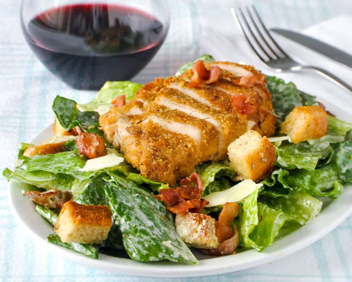 Roasted Garlic Caesar Salad Dressing on a Chicken Caesar Salad