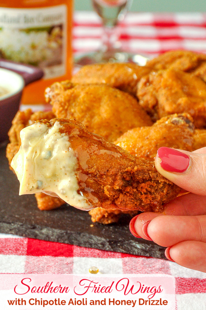 Southern Fried Wings dipped in aioli with title text added for Pinterest