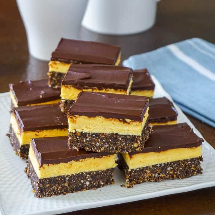 Nanaimo Bars shown on a serving plate.