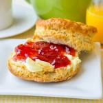 Homemade Butter with Strawberry Jam on Buttermilk Biscuits