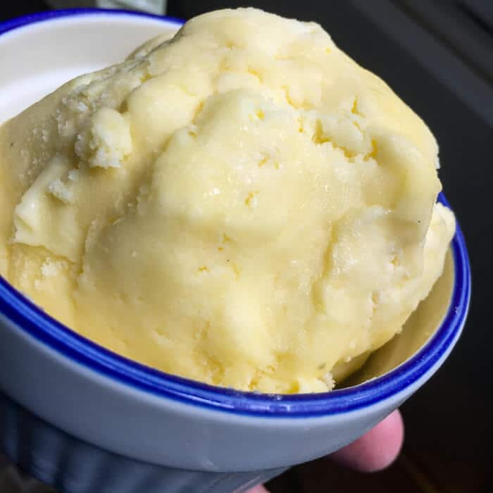 Homemade butter, drained and compressed into a ball.