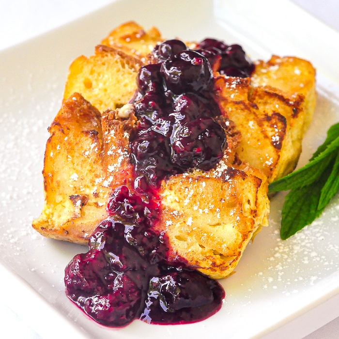 Bread pudding french toast pictured with mint and powdered sugar
