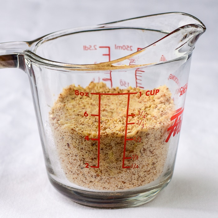 Ground almonds in a clear glass measuring cup