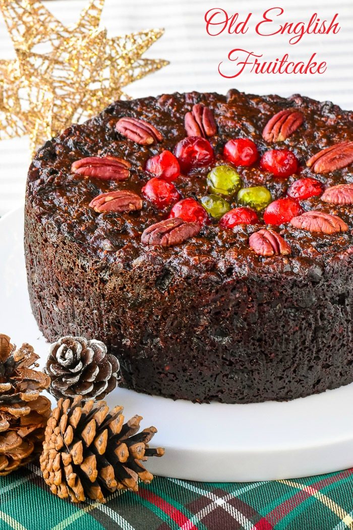 Old English Fruitcake photo of uncut cake with title text added for Pinterest