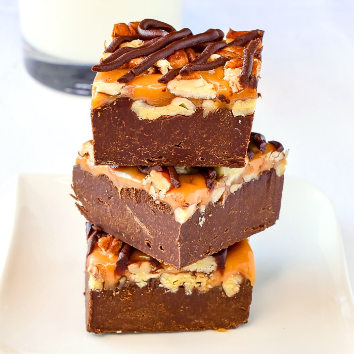 Turtle Fudge stacked on a white plate