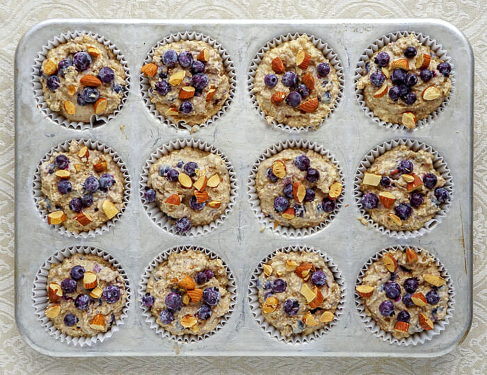Blueberry Almond Butter Muffins in baking tray, ready for the oven, wide shot