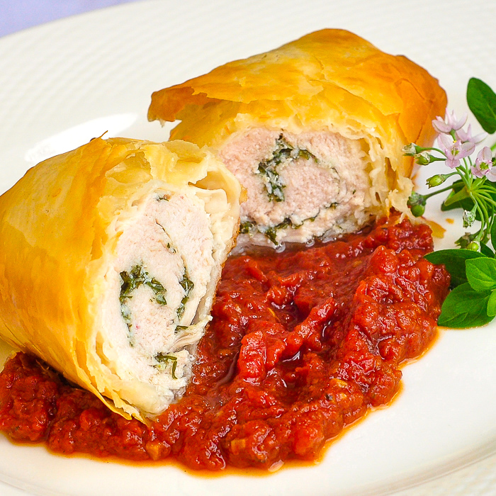 Close up photo of one serving of Phyllo Chicken Herb Roulade with Roasted Tomato Jam