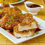 Double Crunch Honey Garlic Pork Chops sliced to show interior after cooking