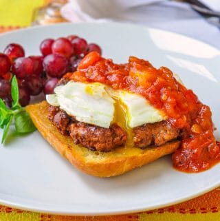 Homemade Chorizo Sausage shown with eggs and spicy tomato compote on toast