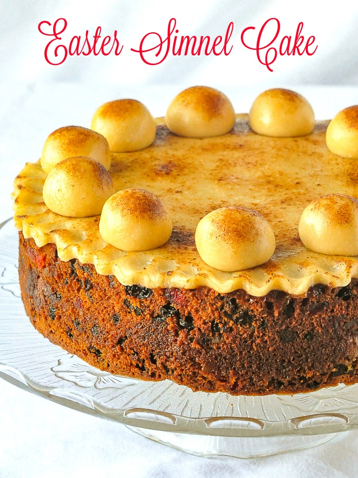 Simnel Cake photo on a clear glass stand with title text added for Pinterest