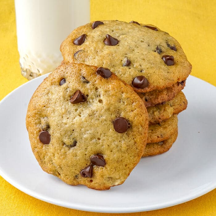 Banana Bread Cookies shown with a cold glass of milk
