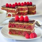 Raspberry Chocolate Mille Feuilles. close up pohoto of one serving on a white plate.