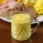 Sweet Mustard Sauce shown in small crystal glass jug