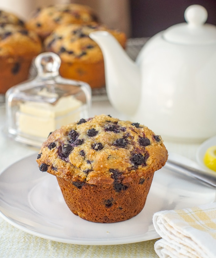 Bakery Style Blueberry Muffins being served at afternoon tea on white dish service