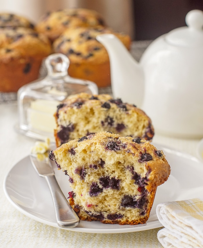 Bakery Style Blueberry Muffins cut in half to show the inside crumb structure