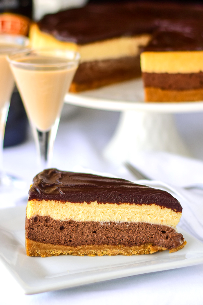 Chocolate Truffle Irish Cream Cheesecake with Bailey's Irish Cream in the background