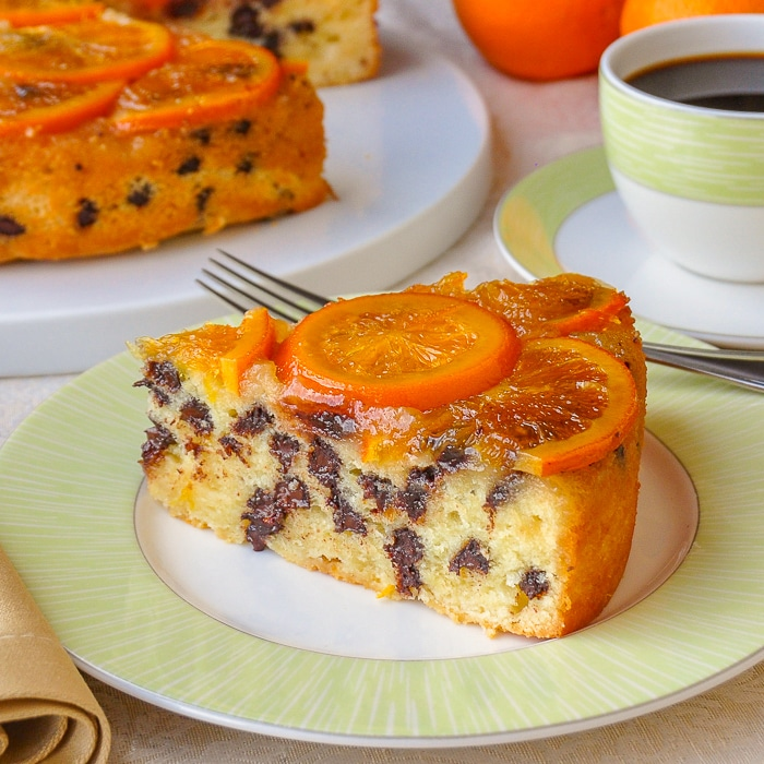 Orange Chocolate Chip Coffee Cake close up photo od single slice on green rimmed plate
