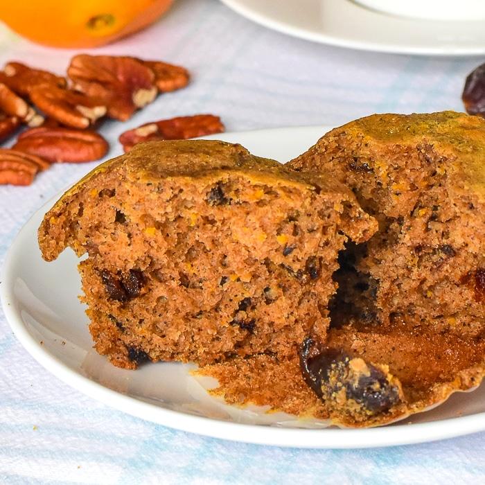 Orange Date Muffins close up photo of one muffin split in half