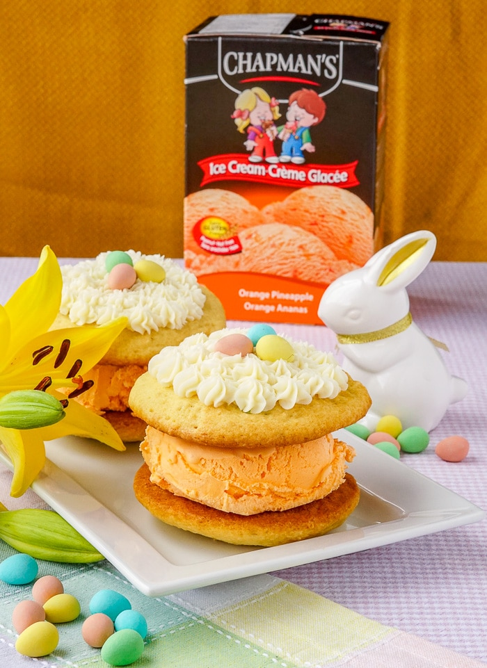 Ice Cream Whoopie Pies shown on pserving plate with Chapman's Ice Cream and decorations in background
