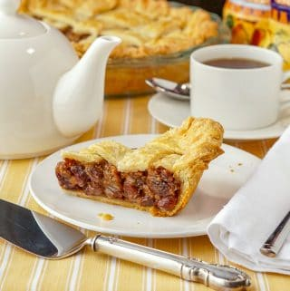 Rum Raisin Pie Featured square image of a slice of pie on a white plate with silver server and teapot surrounding