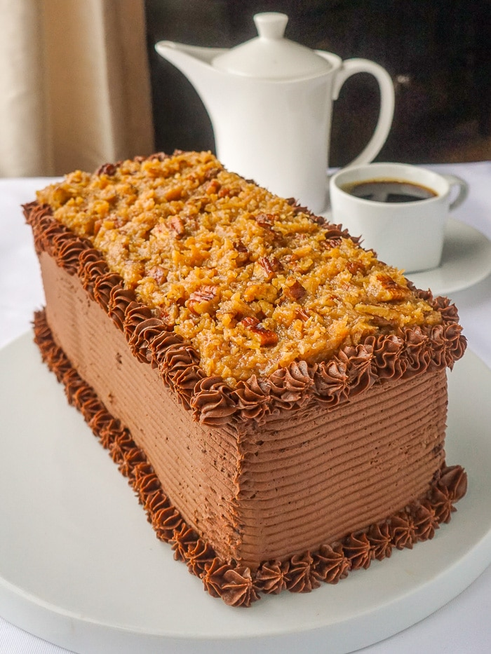 German Chocolate Cake photo of full uncut bar cake on a white cake plate