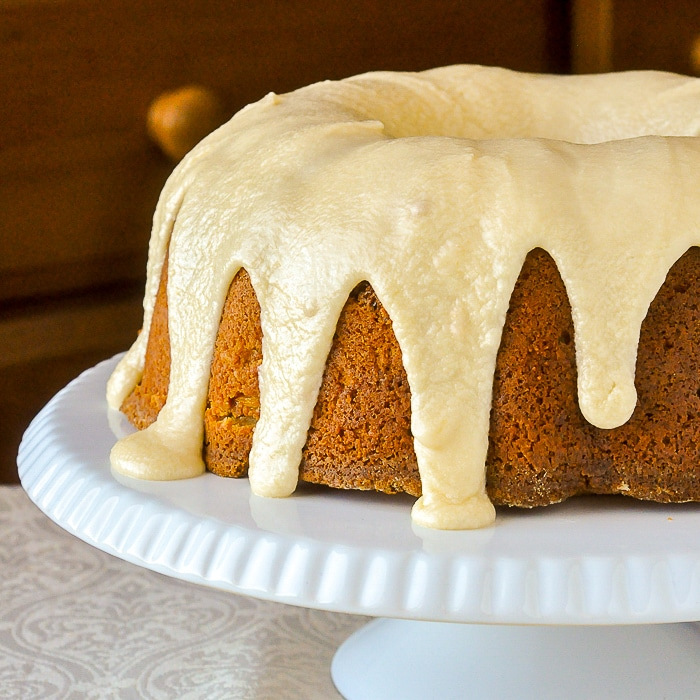 Piña Colada Pineapple Pound Cake photo of uncut cake on a white cake stand