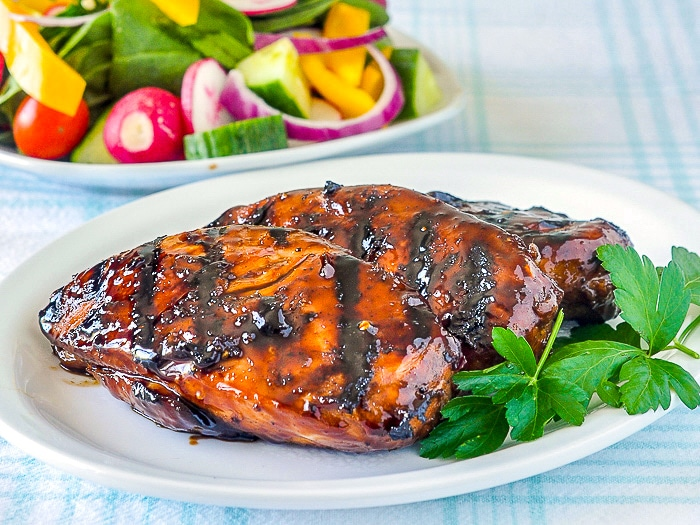 Asian Glazed Chicken Breasts uncut on a white plate