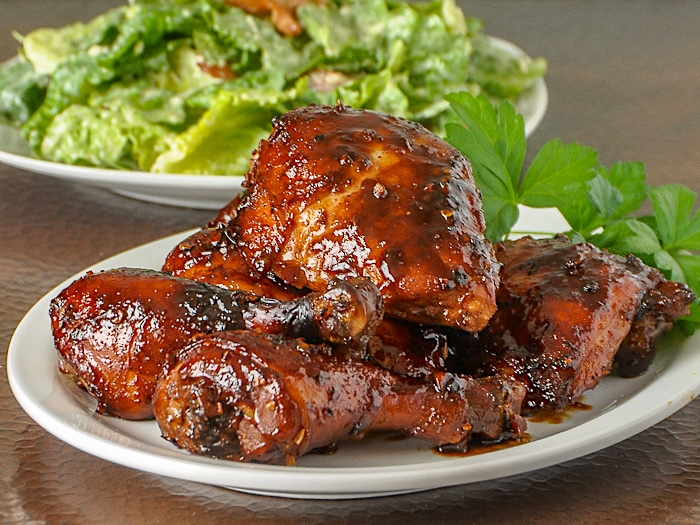 Asian Glazed Chicken pieces with salad in the background
