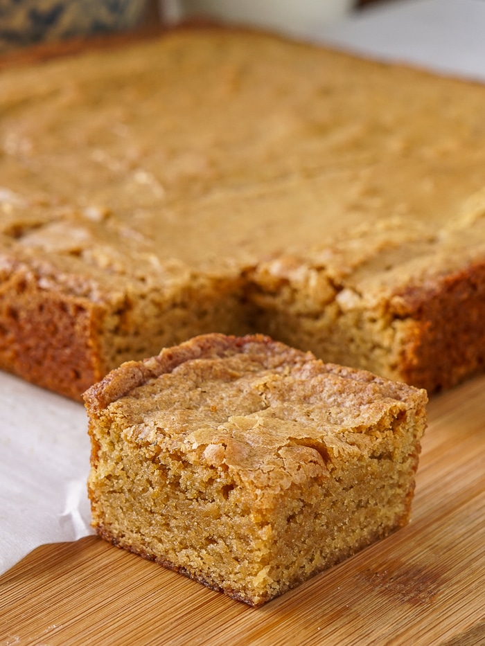 The Best Blondies on a wooden cutting board