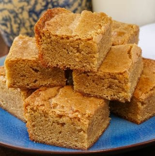 The Best Blondies stacked on a blue plate