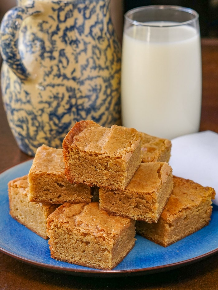 The Best Blondies with glass of milk in background