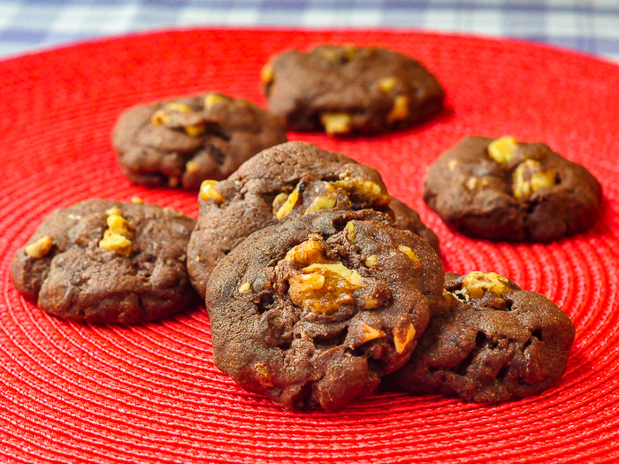 Walnut Brownie Cookies on a red background