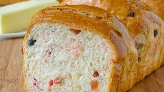 Christmas Fruit Bread close up photo of one sliced loaf of bread