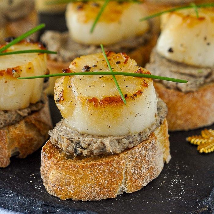 Mushroom Pâté and Seared Scallop Bruschetta close up photo of a single canape