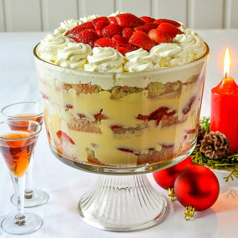 Strawberries and Cream Sherry Trifle square cropped image of trifle in clear glass pedestal bowl