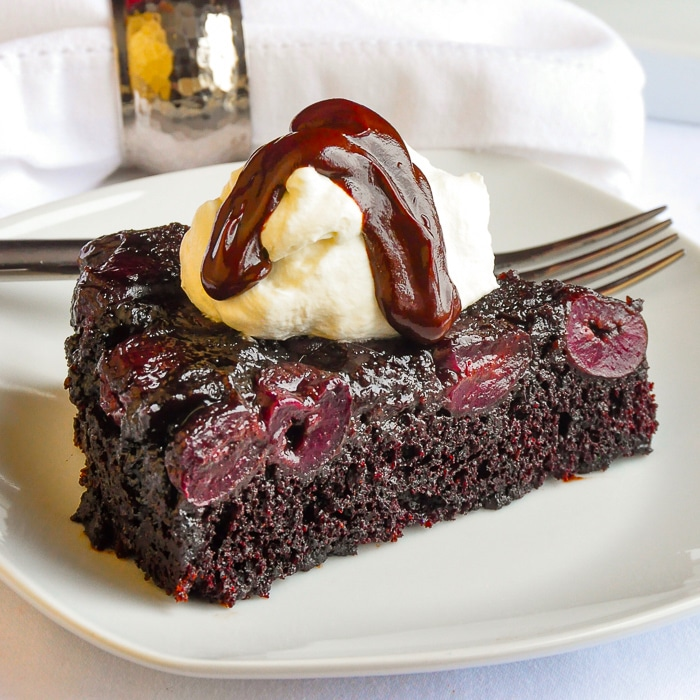 Chocolate Cherry Upside Down Cake single slice on a white plate