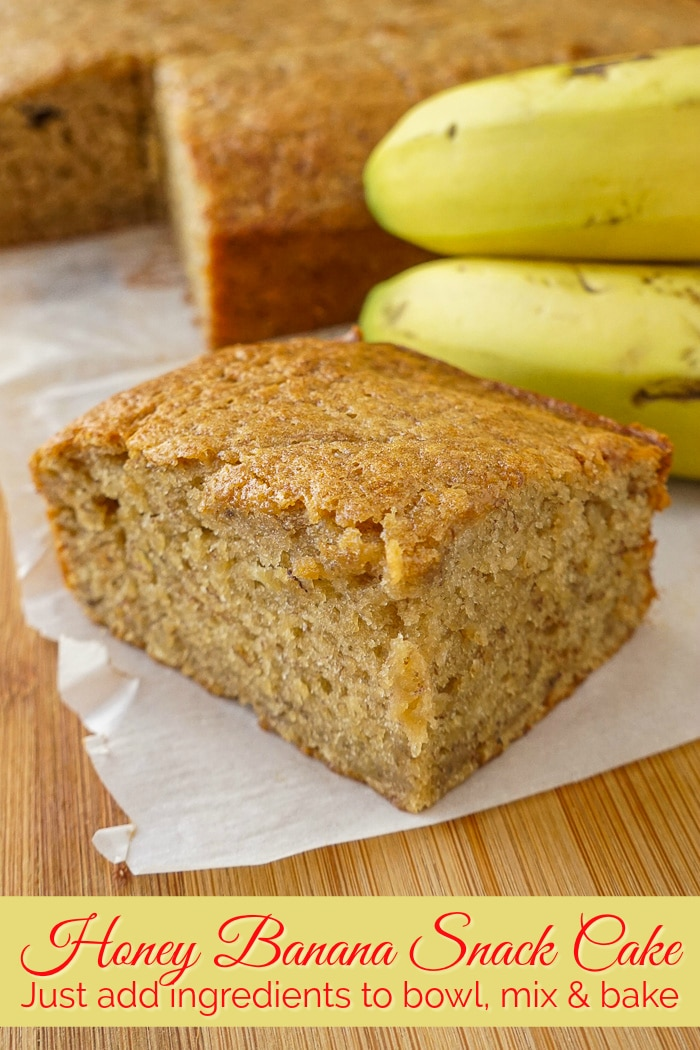Honey Banana Snack Cake on a wooden cutting board with title text added for Pinterest