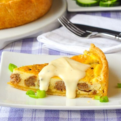 Sausage Garlic Quiche square cropped phot of a single slice with sayce for post featured image