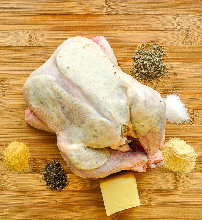 Spice Rack Chicken photo of chicken butter and herbs on a wooden cutting board