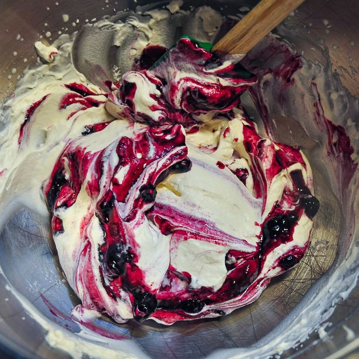 Stop folding when streaks of blueberry are through the cream