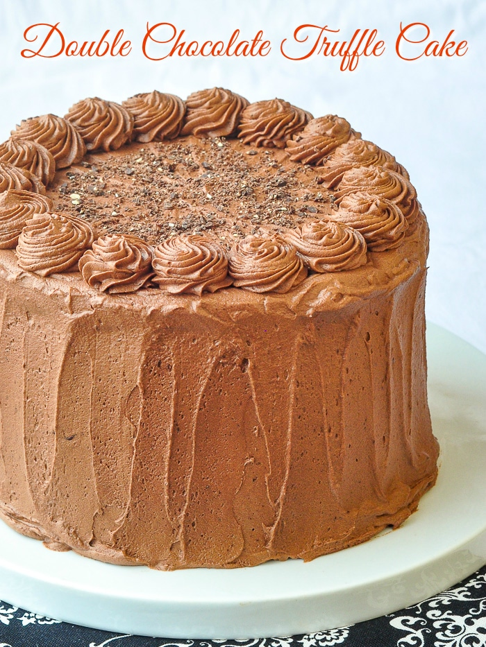 Triple Chocolate Truffle Cake photo of uncut cake with title text added for Pinterest