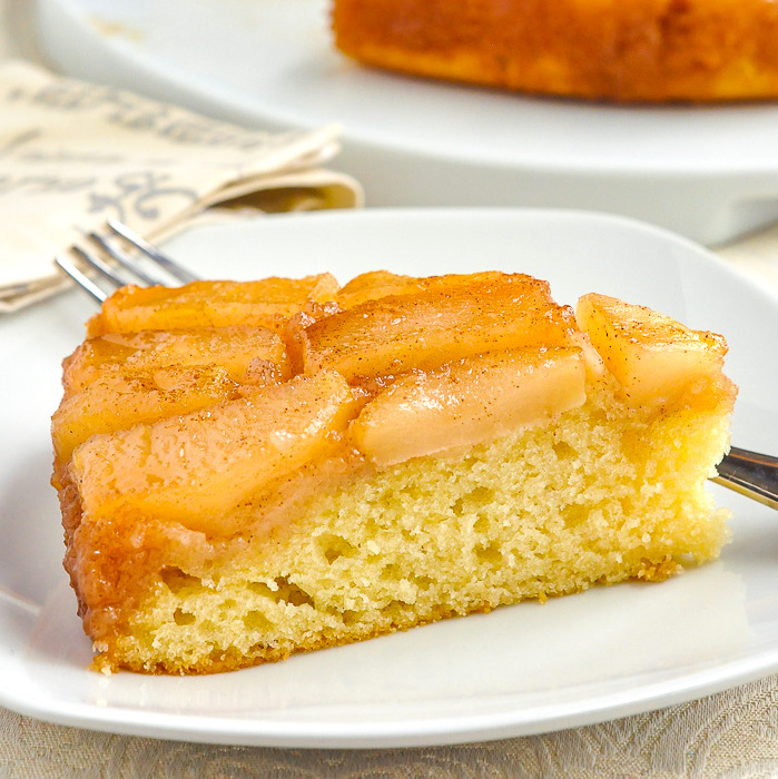 Apple Upside Down Cake close up photo of a single slice on a white plate 1